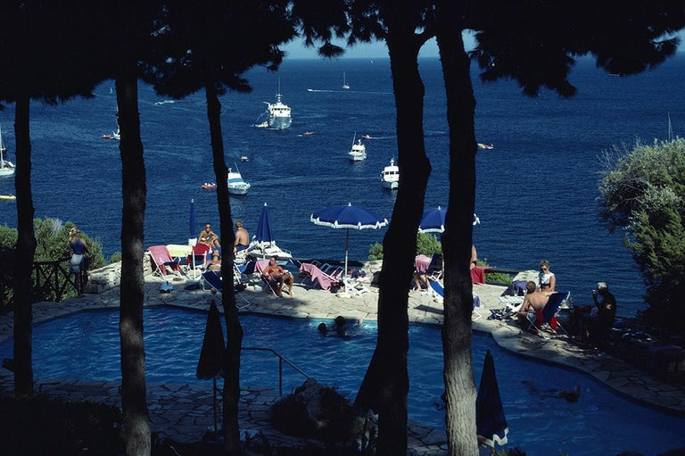 Slim Aarons Estate Edition - Il Pellicano Pool - Photograph by Slim Aarons