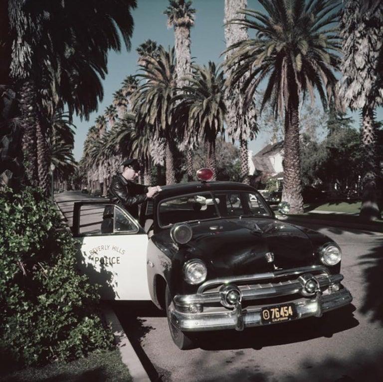 Slim Aarons Estate Edition - Police Patrolman - Photograph by Slim Aarons