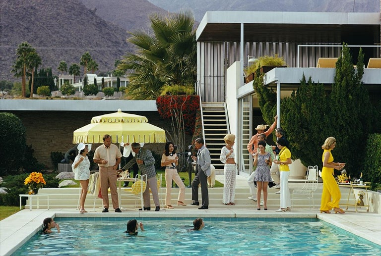 Slim Aarons - Estate Edition - Poolside Party - Photograph by Slim Aarons
