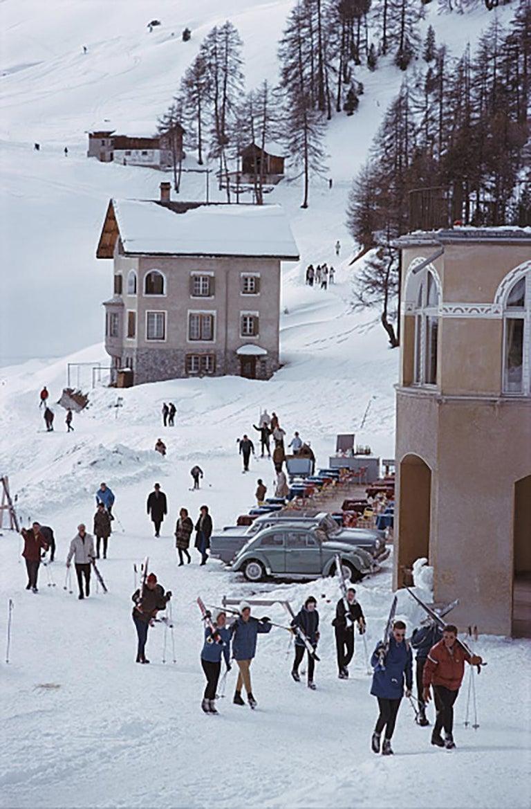 Slim Aarons Estate Edition - Skiers In St. Moritz - Photograph by Slim Aarons