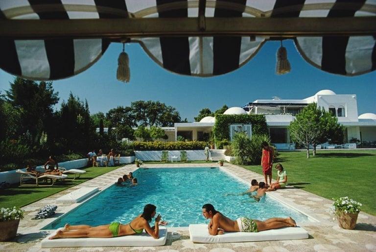 Slim Aarons Estate Print - Poolside In Sotogrande 1975 - Oversize - Photograph by Slim Aarons