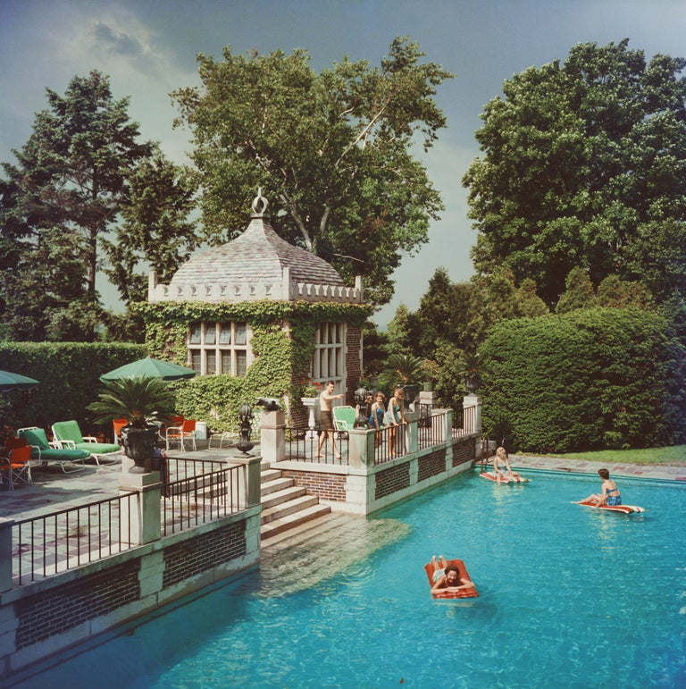 Slim Aarons 'Family Pool' (Slim Aarons Estate Edition) - Photograph by Slim Aarons