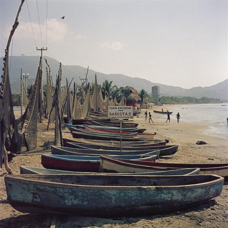 Slim Aarons - Fishing Boats - Estate Stamped  - Photograph by Slim Aarons