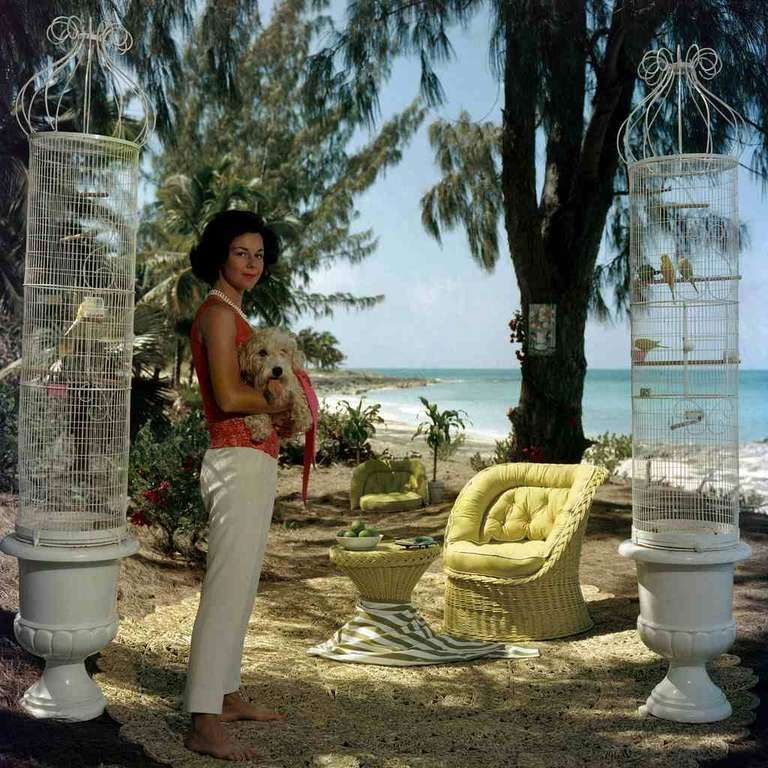 Slim Aarons 'Gloria Schiff at Lyford Cay' - Photograph by Slim Aarons