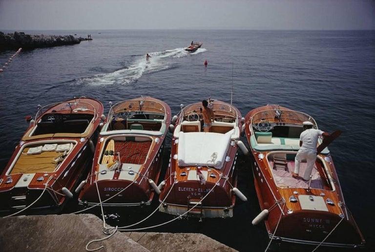 Slim Aarons - Hotel Du Cap-Eden-Roc - Riva Boats  - Estate Edition  - Photograph by Slim Aarons