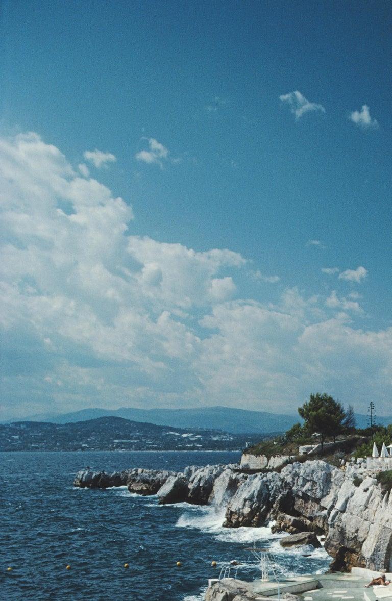 Slim Aarons 'Hotel du Cap Eden-Roc' (Slim Aarons Estate Edition) - Blue Landscape Photograph by Slim Aarons