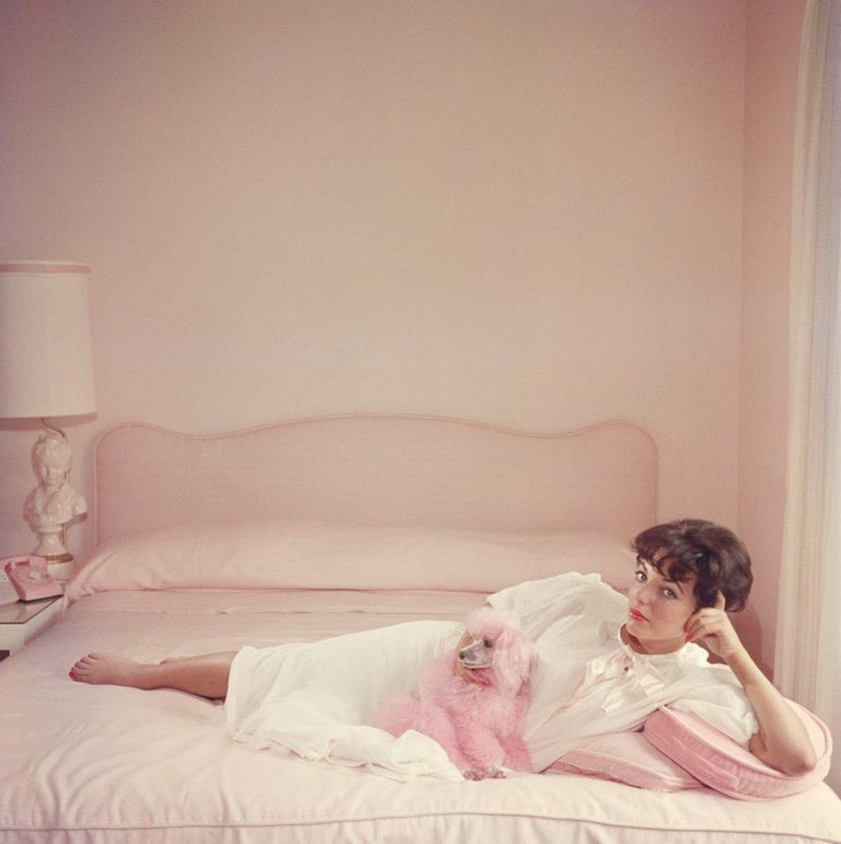 Slim Aarons - Joan Collins Relaxes - Estate Stamped  - Photograph by Slim Aarons