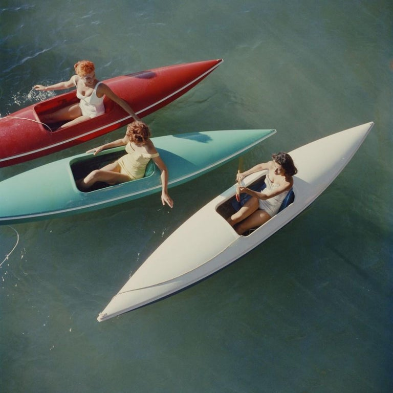 Slim Aarons - Lake Tahoe  Canoes - Estate Stamped  - Photograph by Slim Aarons