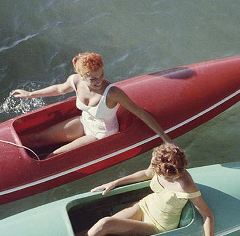 Slim Aarons 'Lake Tahoe Trip' (Canoes, Zephyr Cove, Slim Aarons Estate Edition) - Realist Photograph by Slim Aarons