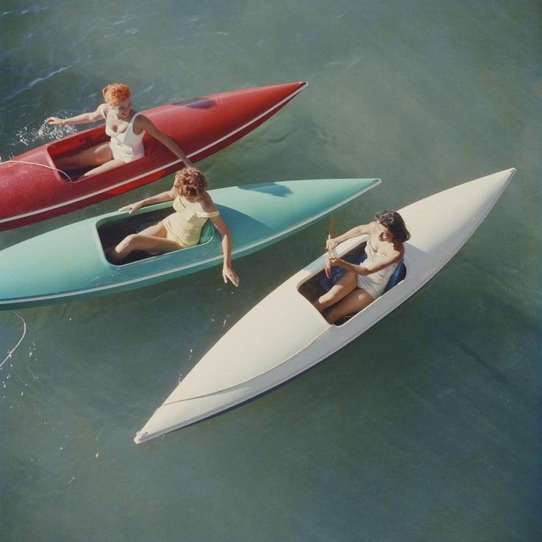 Slim Aarons 'Lake Tahoe Trip' (Canoes, Zephyr Cove, Slim Aarons Estate Edition) - Photograph by Slim Aarons