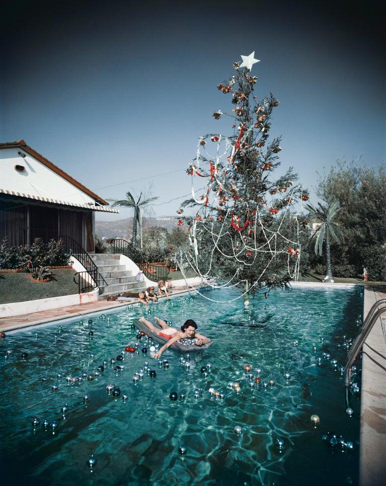 Slim Aarons 'Christmas Swim: Rita Aarons' (Slim Aarons Estate Edition) - Photograph by Slim Aarons