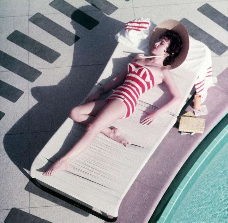Slim Aarons - Mara Lane at the sand - Estate Stamped - Photograph by Slim Aarons