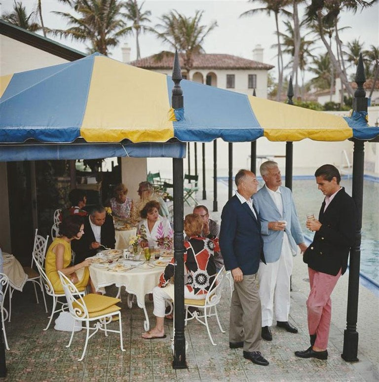 Slim Aarons, Palm Beach Party (Estate Edition) - Photograph by Slim Aarons