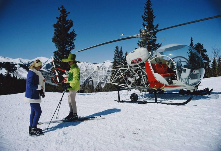 Slim Aarons: Snowmass Village Helicopter (SLim Aarons Estate Edition) - Photograph by Slim Aarons