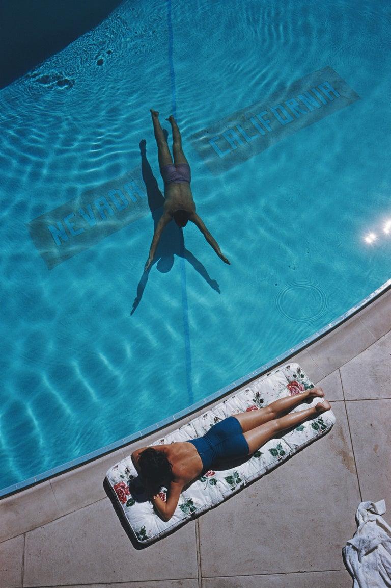 Slim Aarons 'Swimmer and Sunbather, Tahoe' (Slim Aarons Estate Edition) - Photograph by Slim Aarons