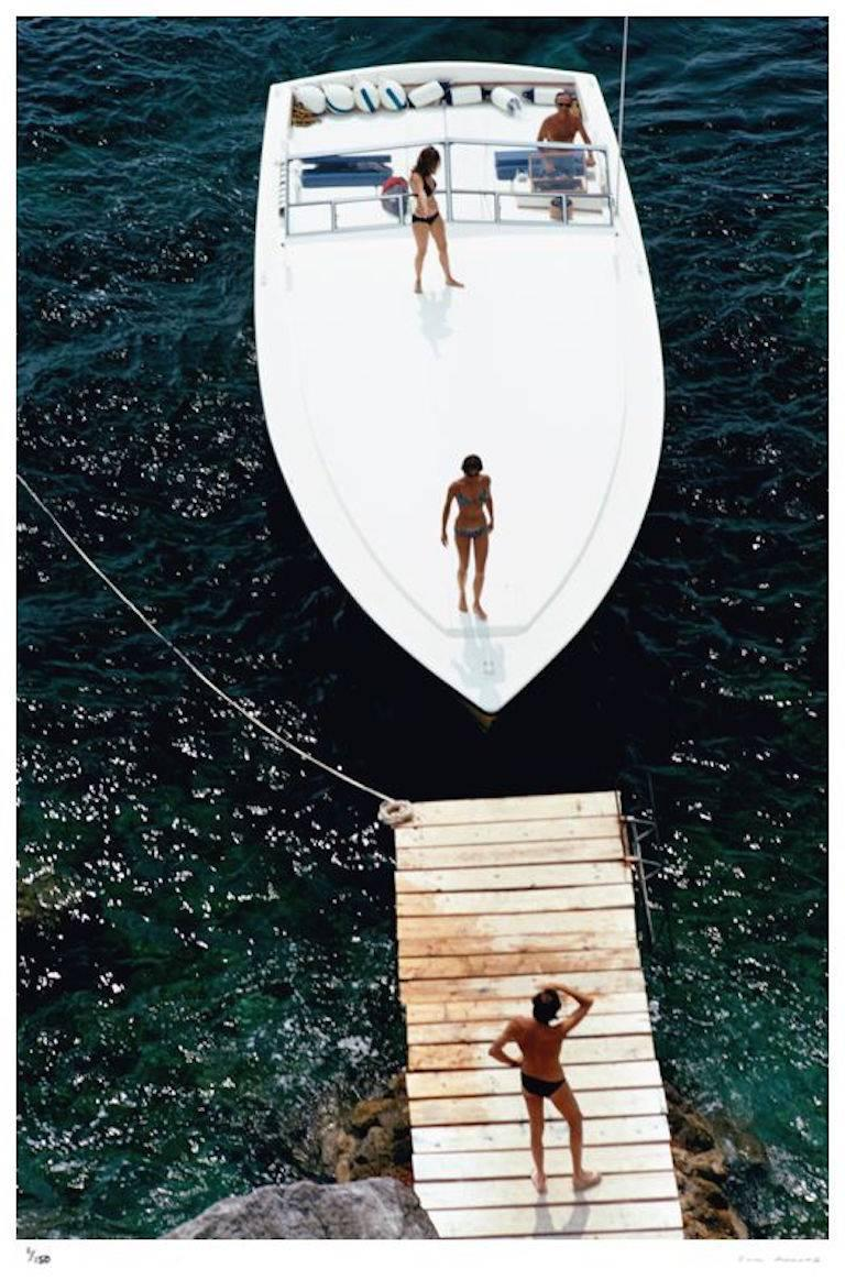 Slim Aarons - Speedboat Landing -  Giant size - Estate Edition - Modern Photograph by Slim Aarons