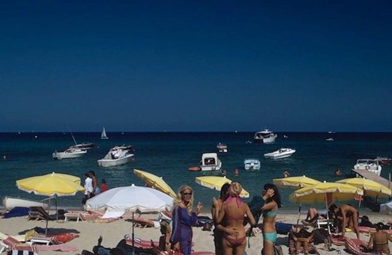 St. Tropez Beach - Slim Aarons, 20th Century, Beach, Nude, Sunbathing, Sunny - American Modern Photograph by Slim Aarons