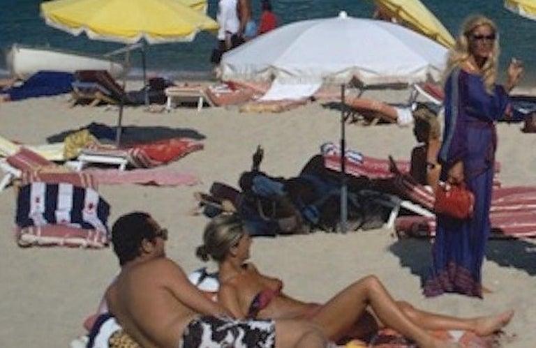 St. Tropez Beach - Slim Aarons, 20th Century, Beach, Nude, Sunbathing, Sunny - Black Landscape Photograph by Slim Aarons