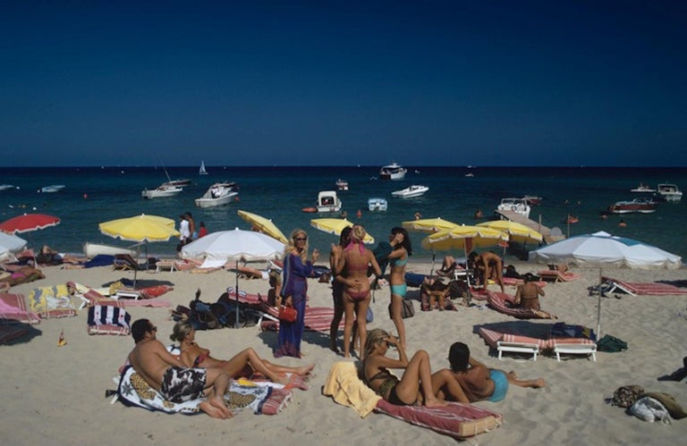 St. Tropez Beach - Slim Aarons, 20th Century, Beach, Nude, Sunbathing, Sunny - Photograph by Slim Aarons