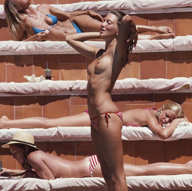 Sunbathing On Capri - Slim Aarons - 20th century colour photography Oversize  - Modern Photograph by Slim Aarons