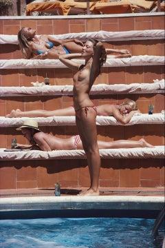 Sunbathing On Capri - Slim Aarons - 20th century colour photography Oversize