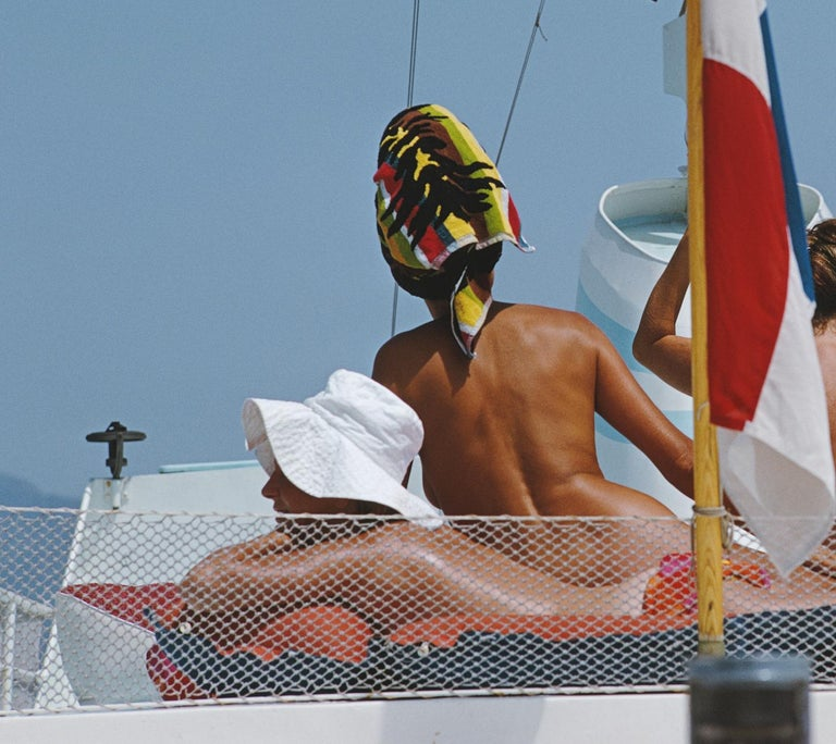 Yacht Holiday - Slim Aarons - 20th century color photography - Nudes - Blue Nude Photograph by Slim Aarons