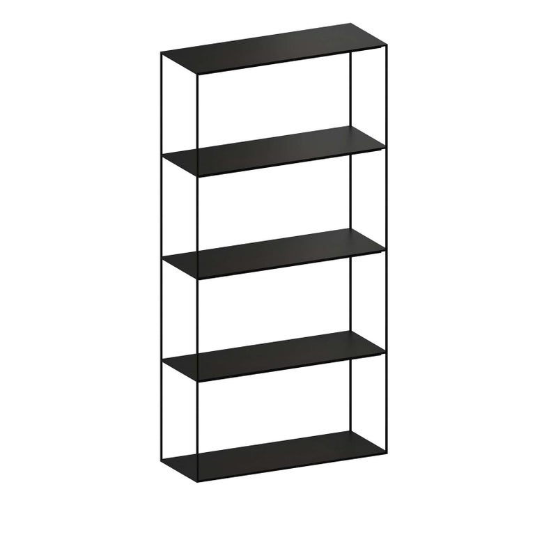 As essential as it gets, the Slim Irony bookshelf is a blank canvas, allowing you to create a personalized composition of books, plants and other decorative elements. In slim metal with a black and copper sand finish, the bookshelf allows you to