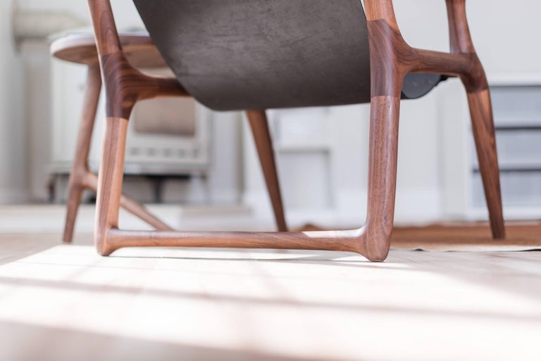 This award winning piece is the inaugural chair design by Fernweh Woodworking. The frame is hand-shaped from high quality American Walnut, providing rich warm brown tones with sleek joinery inspired by Danish, Scandinavian, and mid-century modern