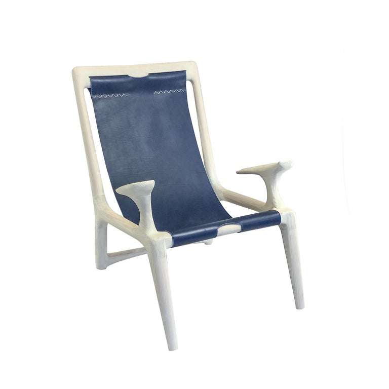 This award winning piece is the inaugural chair design by Fernweh Woodworking. The frame is hand-shaped from high quality white Ash, providing almost a bone color with sleek joinery inspired by Danish, Scandinavian, and Mid-Century Modern design.
