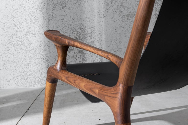 Scandinavian Modern Sling Chair with Leather, Arms Connected, Lounge Armchair Walnut + Black Leather For Sale