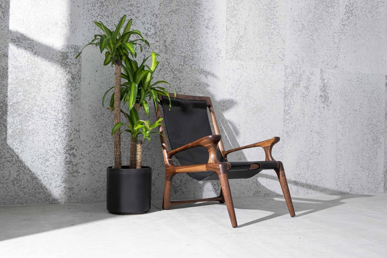 Hand-Carved Sling Chair with Leather, Arms Connected, Lounge Armchair Walnut + Black Leather For Sale