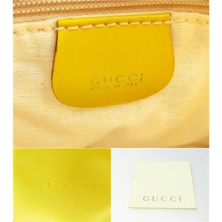 695134114620 Sling Mini 231405 Yellow Patent Leather Backpack For Sale at 1stdibs