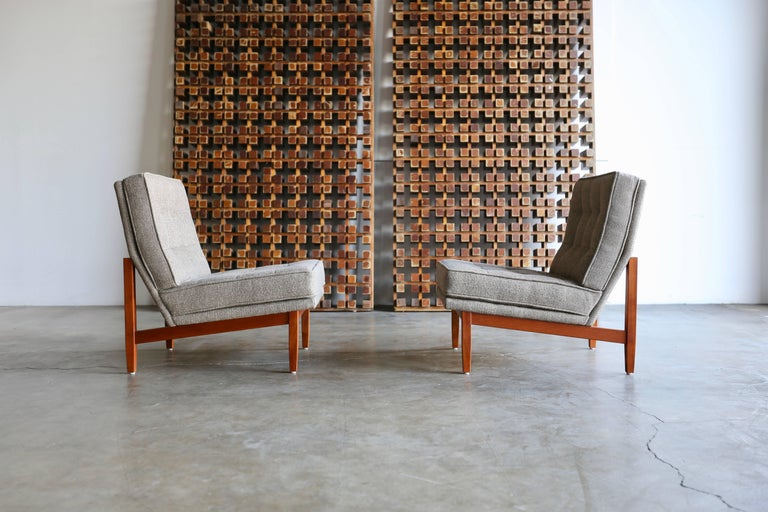 Pair of tufted slipper lounge chairs by Florence Knoll. Manufactured by Knoll, circa 1955. Solid teak wood frames. Freshly upholstered in Holly Hunt Heritage fabric.