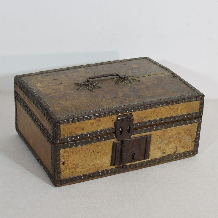 Extremely old box that is covered with leather and decorated with iron and brass. Rare find, France, circa 1600-1700 Weathered and some losses.