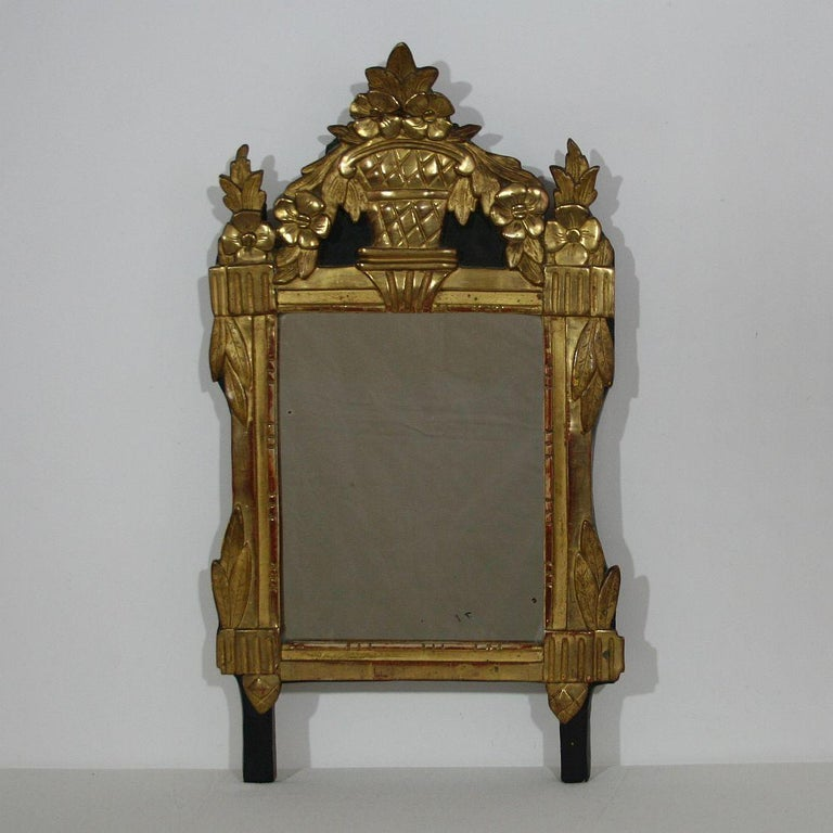 Great gilded mirror from the 18th century, restored and regilded in the 19th century. Glass of later date, France, circa 1780. Weathered, small losses.