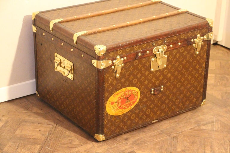 This lovely little Louis Vuitton steamer trunk features stenciled monogram, leather trim, solid brass corners, locks, and side handles. Its brass locks, studs and side handles are all marked Louis Vuitton. It has got a very warm patina. It has got