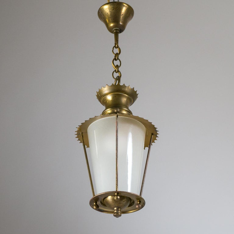 Charming petite French midcentury brass and glass lantern. The conical glass diffuser is frosted on the inside and held by all brass hardware with nice scalloped rims. Fine original condition with patina on the brass. One brass and ceramic E14