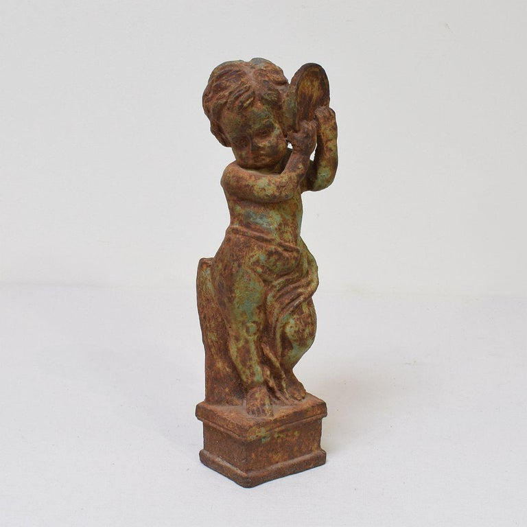 Very nice and small garden statue representing an angel holding an a tambourine.