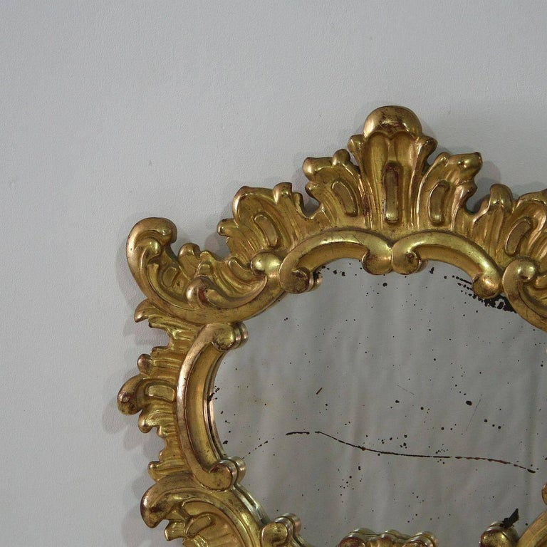 Hand-Carved Small 19th Century Italian Giltwood Baroque Style Mirror For Sale
