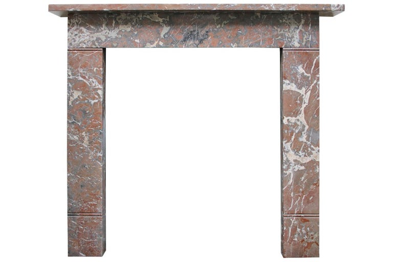 Small 19th century Victorian Rouge marble fireplace surround of simple construction and good color that would sit well within both traditional and contemporary interiors.  Pictured here with an original William IV cast iron hob grate, sold