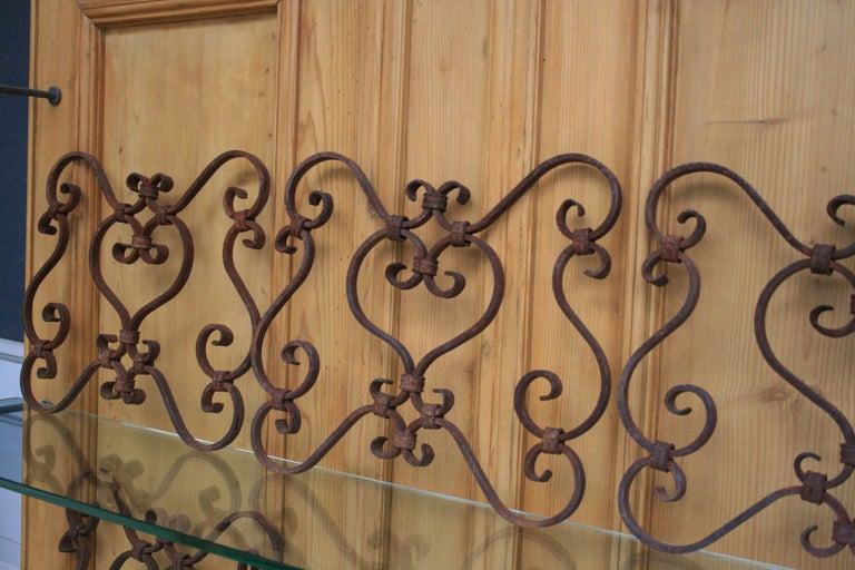 Set of 5 small architectural wrought iron window grills or grates, from the 19th century. Very decorative elements also hanging on the wall.  Dimensions: 34 cm high / 13.38 inch high, 37 cm wide / 14.56 inch wide, 2 cm deep / 0.78 inch deep.