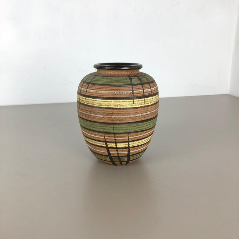Article:  Pottery ceramic vase   Producer:  Dümmler and Breiden, Germany   Decade:  1950s    Description:  Original vintage 1950s pottery stoneware ceramic vase in Germany. High quality German production with a nice abstract
