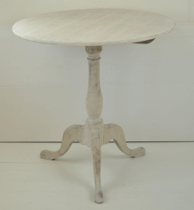 Super little tripod table.  I particularly like the simplicity of this table  Bleached and limed oak.  The piece has been recently limed.  The table originally tipped. It has been converted to a fixed top.