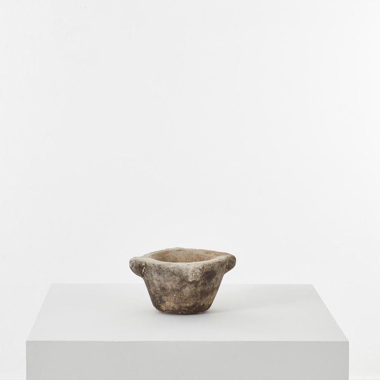 This ancient marble mortar has a rather mysterious aura about it. It is hand sculpted from a single piece of stone, with beautiful ageing over time. Perhaps the most distinctive element of this piece is the chisel marks apparent on close inspection.