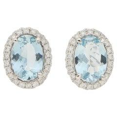 Small Aquamarine and Diamond Halo Stud Earrings Set in 18 Karat White Gold