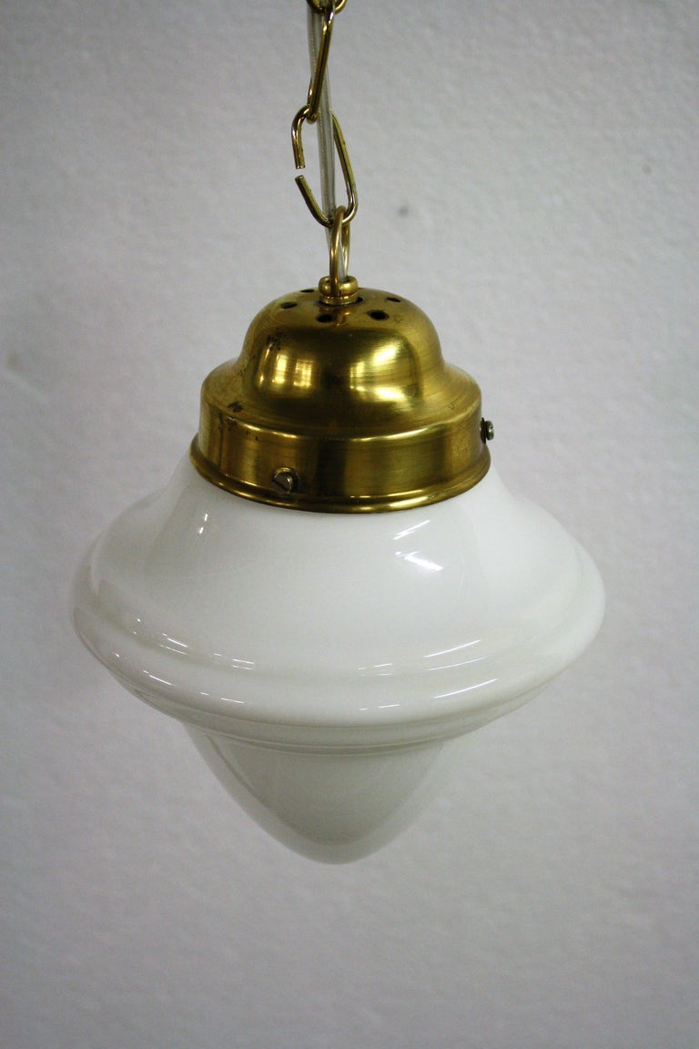 Antique Art Deco era opaline pendant light.  The lamp has a typical Art Deco design.  Supplied with a brass chain and shade holder.  Rewired, tested and ready to use with a regular E27 light bulb.  1930s, France  Measures: Height including