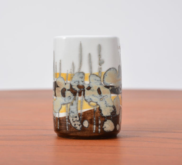 Small Mid-Century Modern Baca vase by Ivan Weiss for Royal Copenhagen, 1960s This small ceramic vase or decorative object is part of the Baca series by Ivan Weiss for Royal Copenhagen. It features an abstract pattern with colors of white, yellow and