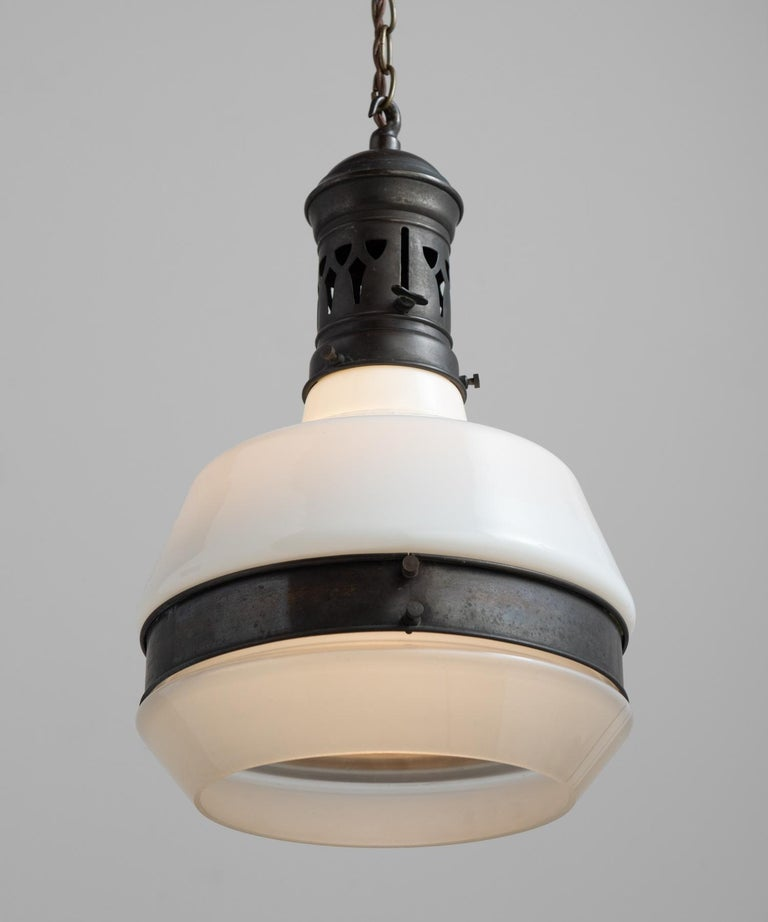 Small Bauhaus pendant, Germany circa 1930.  Unique, angular form with open bottom and metal hardware. Drop adjustable.