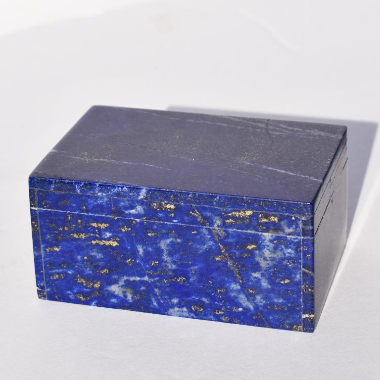 Beautiful blue Lapis Lazuli and Carrara marble stone jewelry box. Created from genuine blue Lapis Lazuli, this box is low in profile and rectangular in form. This lovely jewelry or trinket box features a lid that fits onto its base. Both of which