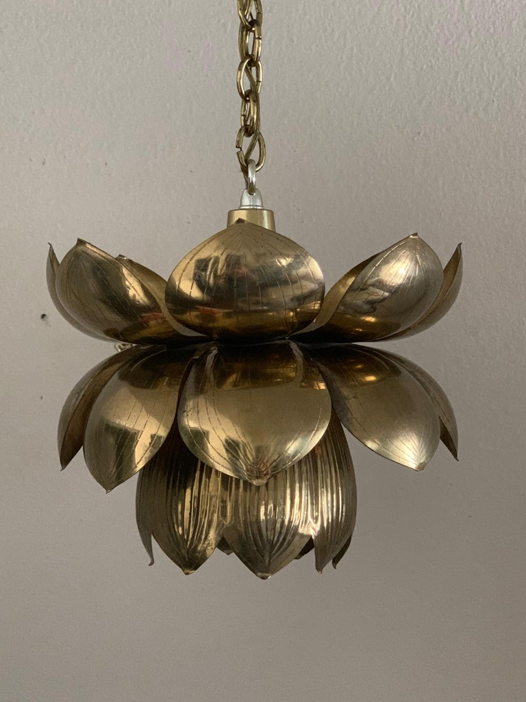Small brass lotus pendant by Feldman. Can be polished if desired for additional $125 Lotus is about 10